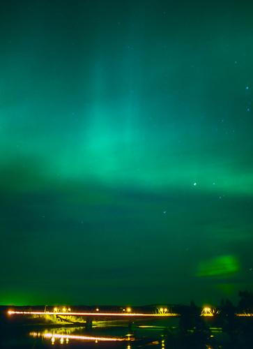 Aurora Borealis over St. Louis bridge, South Saskatchewan River, St. Louis, Saskatchewan. (Darrell Noakes)